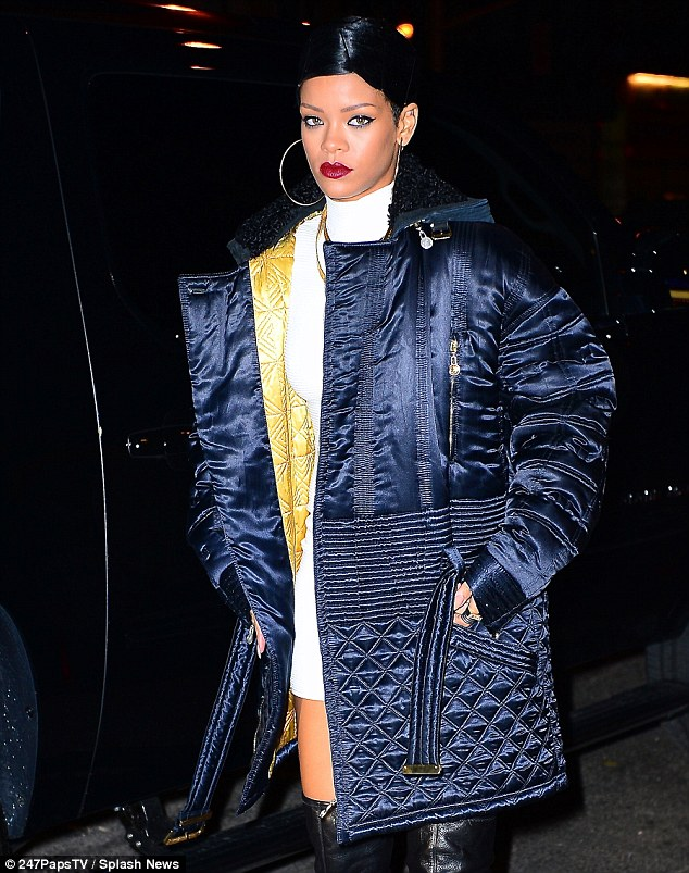 Wrapping up: Rihanna wore a navy blue quilted jacket over her dress to protect her from the chilly Manhattan temperatures