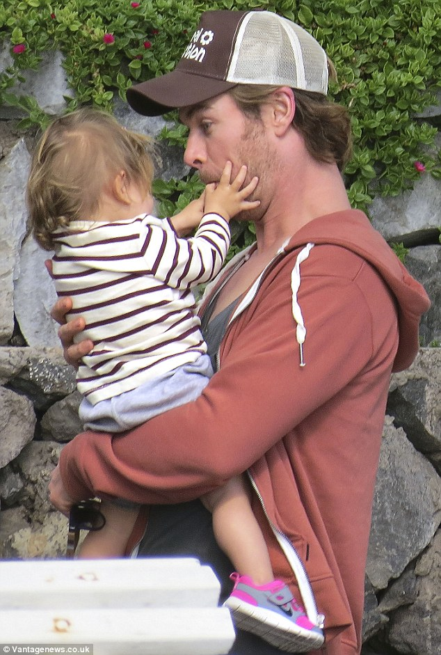 Mmm delicious! The youngster had a ball trying to pry her daddy's mouth open and he happily played along