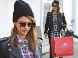 She's been nice this year! Leather-clad Jessica Alba carries bags of stylish treats after a pre-Christmas shopping trip