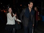 Mystery: Catwalk star David and a female friend leaving The Groucho Club in London's Soho