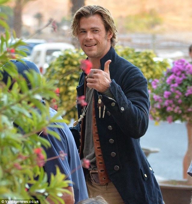 Seaman style: Chris Hemsworth returns home from filming in the same swashbuckling outfit as his character