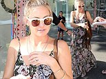 Kate Hudson beats the heat in a pretty floral maxi dress as she treats herself to a Sydney shopping spree