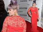 Festive: Kelly Osbourne steps out in a bright red dress decorated with a bow