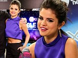 Making her presence known! Selena Gomez displays her amazing abs in purple crop top at the Z100 Jingle Ball