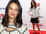 Katie Holmes parades her pins in a ruffled miniskirt at New York's Jingle Ball but keeps it casual in studded grey sweater