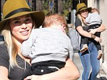 Hilary Duff carries sleeping son
