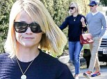 Post holiday blues! Reese Witherspoon shows how to do casual chic in denim and navy as she and husband Jim Toth adjust to life after their Paris getaway