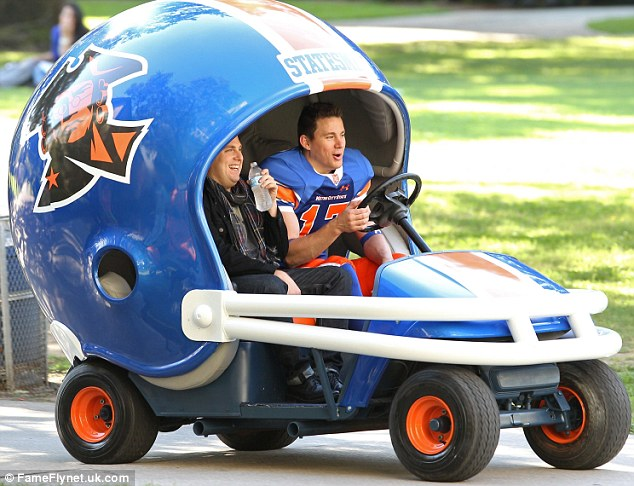 Behind the wheel: The action star seen filming the sequel to 21 Jump Street with co-star Jonah Hill
