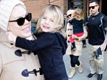 Mum's little snuggle bug! Willow Hart cuddles into mother Pink to escape New York's cold