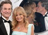 Still so in love after 30 years! Goldie Hawn steals a kiss from partner Kurt Russell as she is honoured at amfAR gala