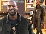 The smile that shows he has found Kim's perfect present! Kanye West breaks out into a rare grin after shopping at Chanel