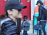 Sandra Bullock can't hide her proud smile as she drops little Louis off at school