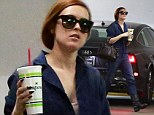 Actress Rumer Willis rocks a blue jumpsuit while stopping by an office building in Los Angeles
