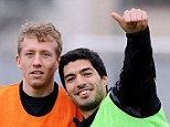 Thumbs up: Luis Suarez could skipper Liverpool at White Hart Lane
