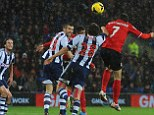 Rising above: Peter Whittingham beats the West Brom tall timber to head home for Cardiff to make it 1-0