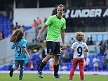 Family man: Soldado was joined on the pitch by his children Daniela and Enzo following the win over Swansea