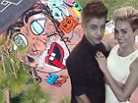 Justin Bieber pays tongue-in-cheek tribute to Miley Cyrus by spray painting a portrait of her on his skateboard ramp