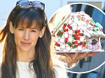 What talent! Jennifer Garner puts her candy-studded gingerbread house on proud display as she ferries her brood to a holiday party