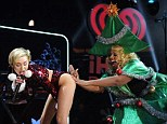 It's not a Miley Cyrus performance without some twerking: The singer got up close and personal with a Christmas tree during her performance