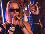 Macaulay Culkin plays a kazoo