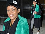 Rihanna trades in her stilettos for sneakers to match her unusually casual outfit as she leaves the stylish Milk Studios