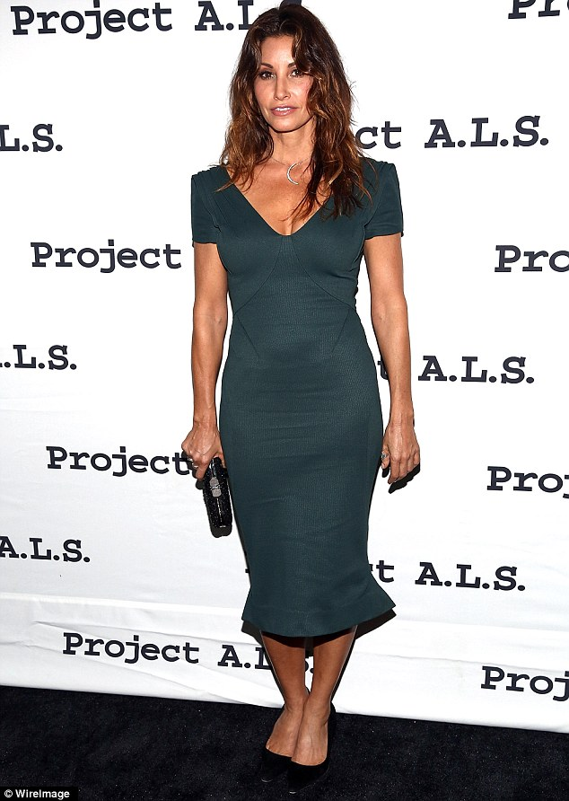 Green with envy: Gina Gershon made a sexy entrance in a clingy green frock as she attended the Project A.L.S. 15th Anniversary Party on on Thursday in New York