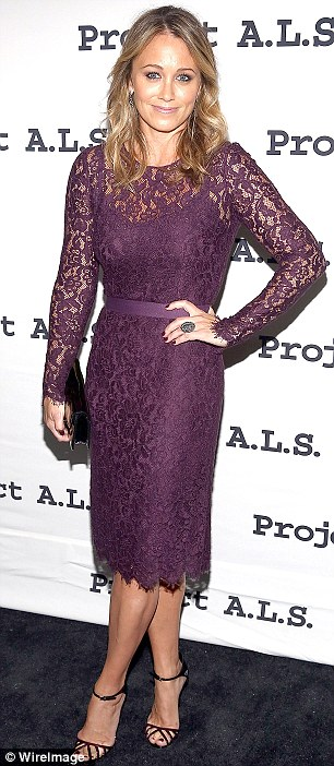 Lacy and debonair: Christine Taylor wowed in a lacy purple dress and delicately strapped heels while Paul Rudd suited up nice in grey