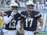 Air it out: San Diego quarterback Philip Rivers (right) threw three touchdown passes in an easy win for the Chargers