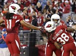 All smiles: The Arizona Cardinals stayed alive in the playoff hunt with an easy win over St Louis