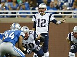 1st Down: New England Patriots quarterback Tom Brady (12) gets set to run a play against the Detroit Lions