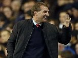 High five: Liverpool manager Brendan Rodgers gestures to the bench