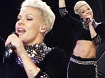 Pink puts her incredibly toned tummy on display as she performs final 2013 tour date in steel studded crop top
