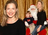 What's on your wish list? Ali Larter gets the giggles on Santa's lap as she attends children's charity event with her family