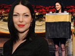 Laura Prepon dresses up as a battery at the Scientology Celebrity Centre's star-studded Christmas party