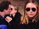 Mary-Kate Olsen kisses boyfriend at Knicks game