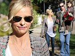 What a happy family! Sarah Michelle Gellar gazes adoringly at Freddie Prinze, Jr. and daughter Charlotte on rare outing together