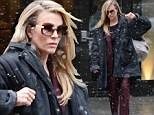 Beautiful even in a blizzard! Kim Basinger, 60, defies her years in burgundy pantsuit to promote new film in snowy New York
