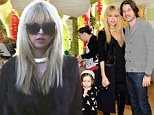 Fashionably festive: Nine months pregnant Rachel Zoe steps out in thigh-high suede boots with her family at Baby2Baby Holiday Party