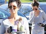Kourtney Kardashian bed head hair on coffee run