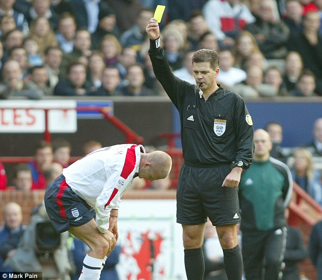Smart move? David Beckham later claimed he had been 'clever' in picking up the booking against Wales which meant he would serve a one-game ban while injured