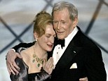 Loved: Actor Peter O'Toole is embraced by actress and presenter Meryl Streep after she presents him with his honorary Oscar