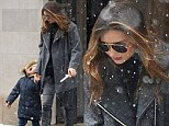 Miranda Kerr's son Flynn gets a taste of snow as pair step out in freezing cold New York