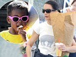 No cosmopolitans here! SATC actress Kristen Davis takes daughter Gemma to farmer's market to pet the animals