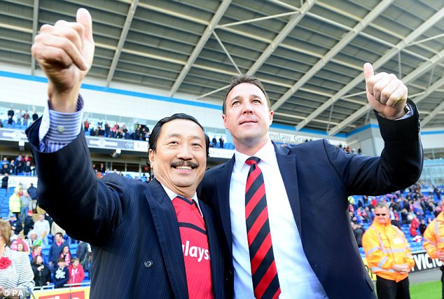 Too much, too soon: Cardiff chairman Vincent Tan (left) has made unreasonable demands of manager Malky Mackay