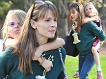 That's my girl! Jennifer Garner treats daughter Violet to a piggyback ride after she scores another trophy at soccer