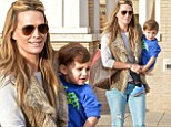 Mother of one: Molly Sims went shopping on Sunday with her young son Brooks in Beverly Hills, California