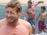 Shirtless Simon Baker displays muscular physique while Down Under at Bondi Beach with his family
