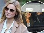 The smile that says it all: Jennifer Aniston and Justin Theroux quash split rumours as they join Kristen Bell for festive get-together