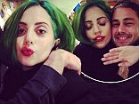 She doesn't need the green light! Lady Gaga still has her Christmas tree inspired locks in candid photos with boyfriend Taylor Kinney