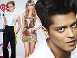 Bruno Mars beats out Miley Cyrus and Taylor Swift as he snags Billboard's Artist Of The Year